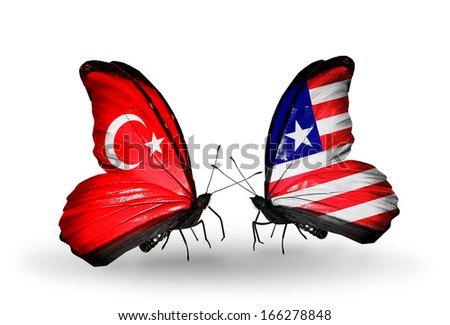 Two butterflies with flags on wings as symbol of relations Turkey and Liberia - stock photo