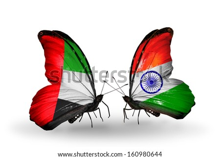 Two butterflies with flags on wings as symbol of relations UAE and India - stock photo
