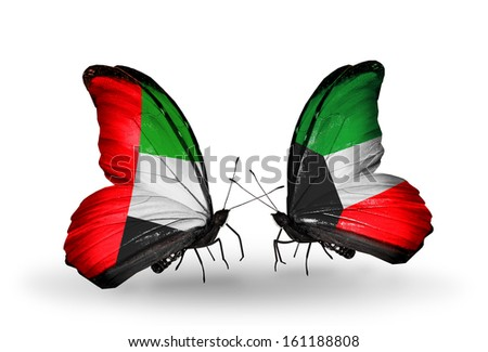 Two butterflies with flags on wings as symbol of relations UAE and Kuwait - stock photo