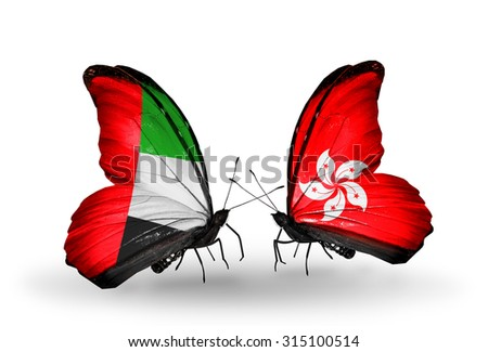 Two butterflies with flags on wings as symbol of relations United Arab Emirates and Hong Kong - stock photo