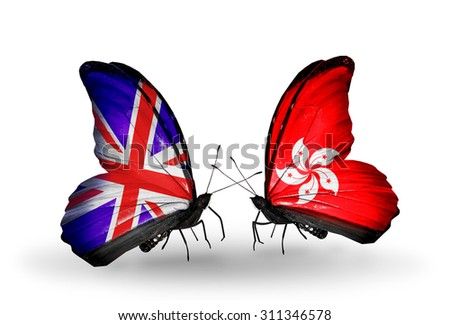 Two butterflies with flags on wings as symbol of relations United Kingdom and Hong Kong - stock photo
