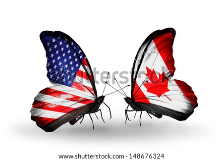 Two butterflies with flags on wings as symbol of relations USA and Canada - stock photo