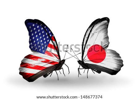 Two butterflies with flags on wings as symbol of relations USA and Japan - stock photo