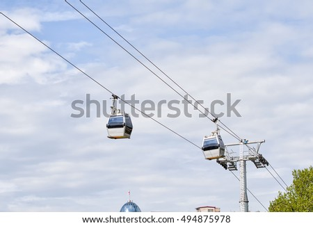 Two cabins cable car against the sky, Tbilisi