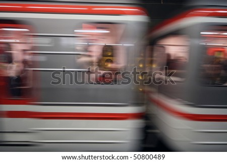 Two cabins of a modern European metro line rushing by - stock photo