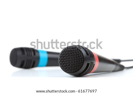 Two cable microphones. Isolated on white background, small DOF - stock photo