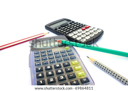 Two  calculators and three pencils isolated on white background. - stock photo