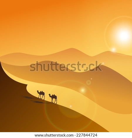 Two camels in the evening desert - stock photo