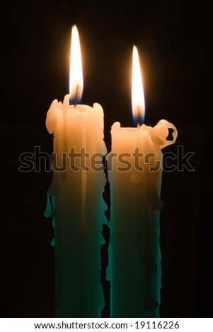two candles in the dark