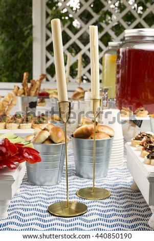 Two candles on catering service. Restaurant table with food at event. Selective focus.