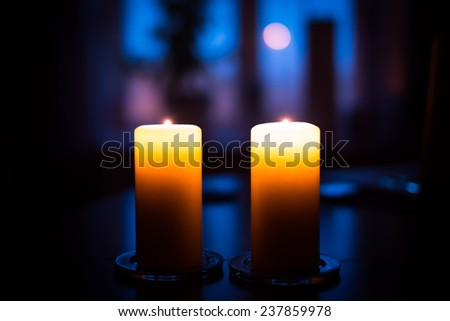Two candles on table - stock photo