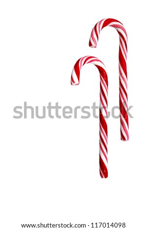 Two candy canes isolated on white background. Christmas, holiday concept. Space for copy. Useful as greeting card. Clipping path included. - stock photo