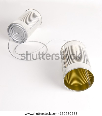 Two Cans Strung Together With Metal Wire Walkie Talkie - stock photo