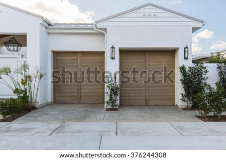Two car garage door, staggered - stock photo