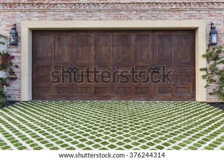 Two car garage door with a grassy texture - stock photo