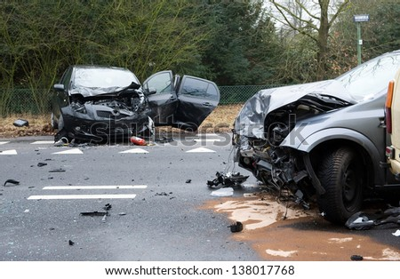 Two cars who crashed into another car on a interstate road - stock photo