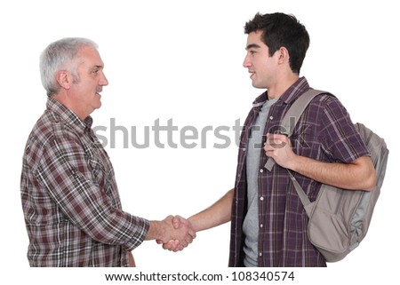 Two casual men shaking hands - stock photo