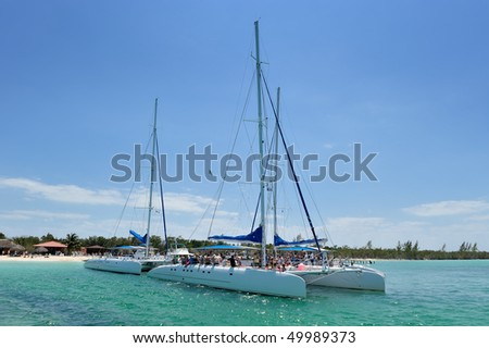 Two catamarans at harbor in tropical island