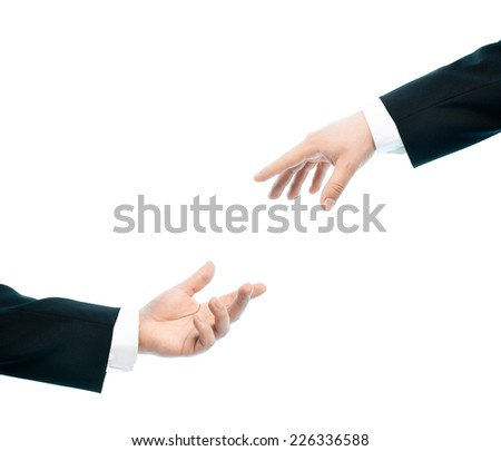 Two caucasian male hands composition of giving a hand of help, high-key light composition isolated over the white background - stock photo