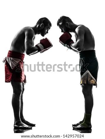 two caucasian  men exercising thai boxing saluting in silhouette studio  on white background - stock photo