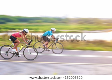 two caucasian sports women exercising outside.horizontal image - stock photo