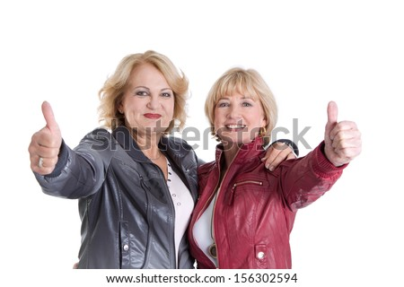 Two Caucasian women smiling at the camera.  - stock photo