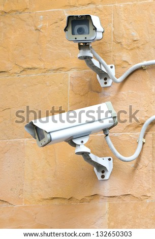 Two CCTV security cameras.
