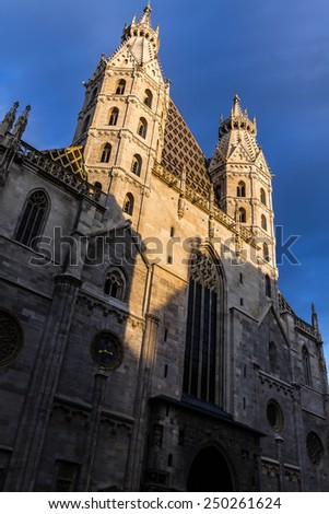Two central towers of the Cathedral of St. Stephen in the Austrian capital, Vienna. Catholic Cathedral of the city under the setting sun - stock photo