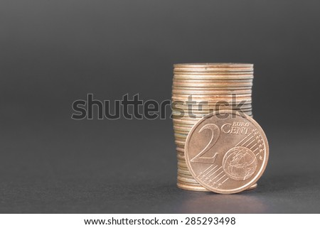 Two cents of euro isolated on a dark background to understand a business concept - stock photo