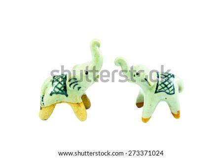 two ceramic elephant on the white background - stock photo
