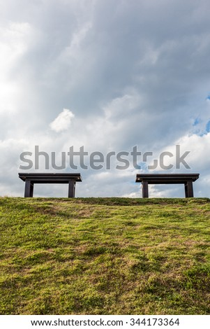 Two chair on the park sky and white cloud, selective focus. - stock photo