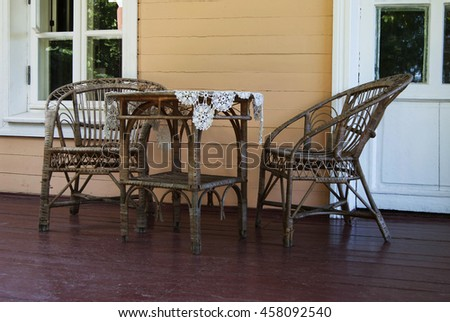Two chairs and table made of rattan on the balcony - stock photo