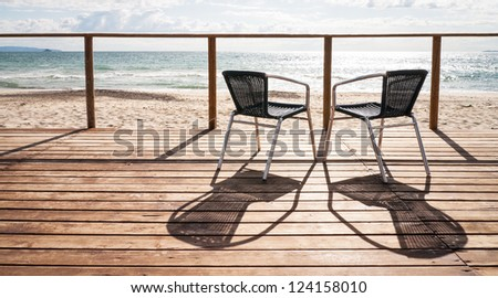 two chairs at a patio - stock photo