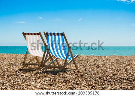 Two chairs at the beach.  - stock photo