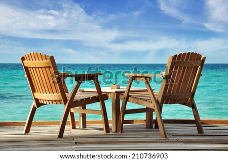two chairs at the water