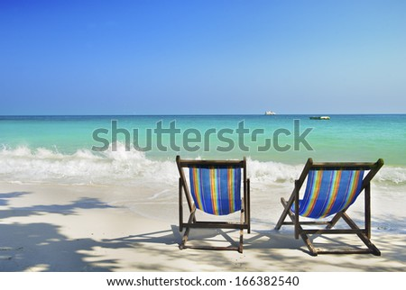 two chairs in sea sand sun - stock photo
