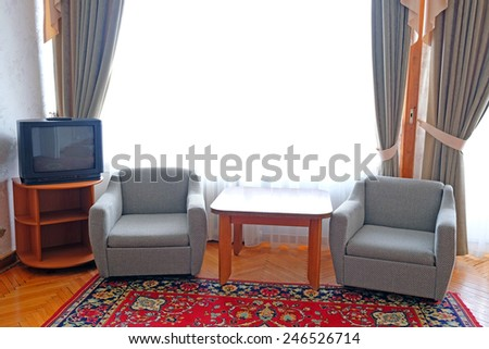 two chairs in the suite room at motel - stock photo