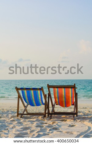 Two chairs on beach in early morning sun