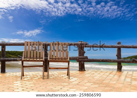 Two chairs on terrace near the beach - stock photo