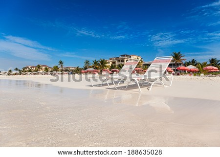 Two chairs on the white sands of Grace Bay Beach, Providenciales, Turks and Caicos - stock photo