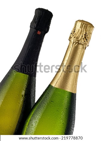 Two champagne bottles with drops, close up - stock photo