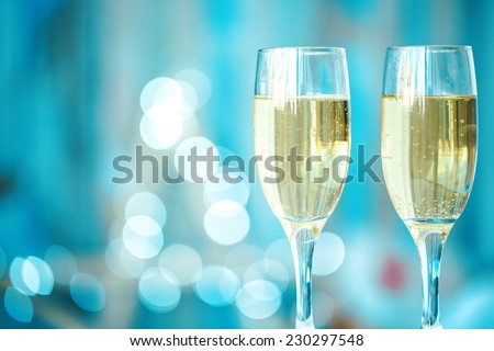 Two champagne glass on christmas bokeh background - stock photo