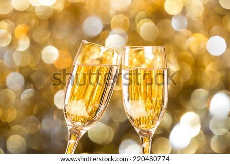 Two champagne glass on christmas bokeh background Two champagne glass on christmas bokeh background - stock photo
