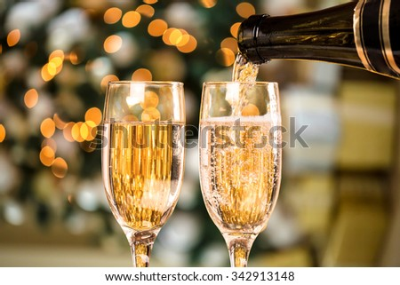 Two Champagne Glass On Defocused Background Living Room With Christmas Tree