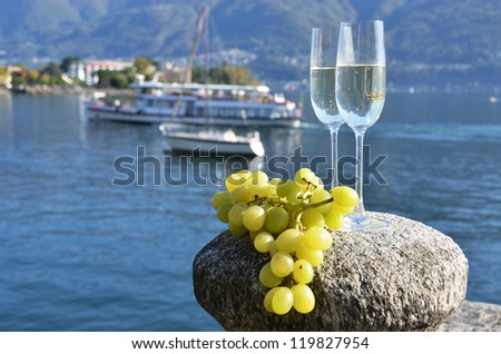 Two champagne glasses and grapes - stock photo