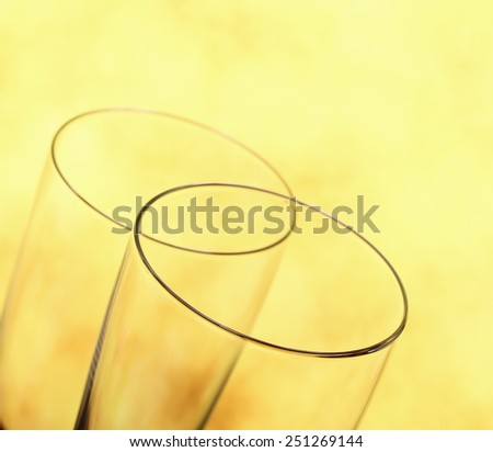 Two Champagne glasses as wedding rings symbol, blurred background - stock photo