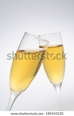 two champagne glasses on gradient background - stock photo