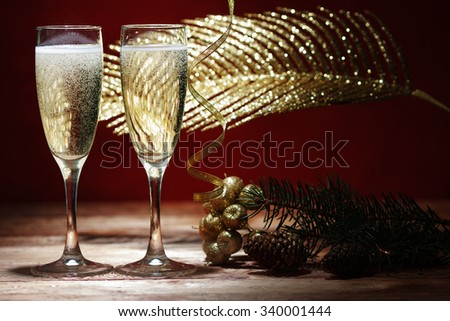 Two champagne glasses on wooden table - stock photo