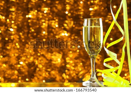 Two Champagne glasses on yellow light bokeh background