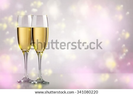 Two champagne glasses over background with copy space - stock photo